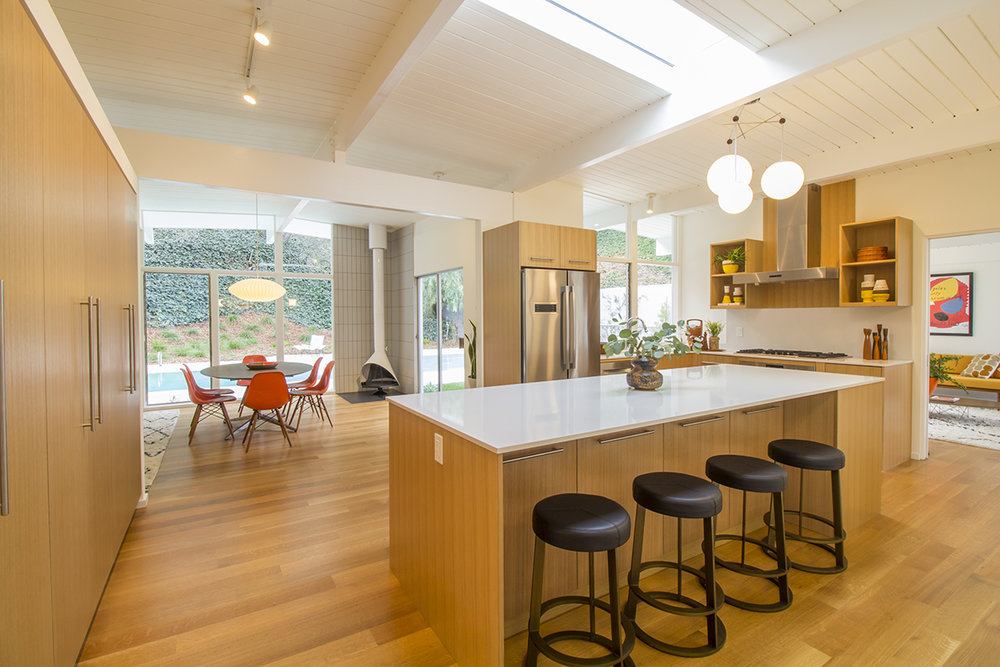12 Kitchen and dining to pool whole room.jpg