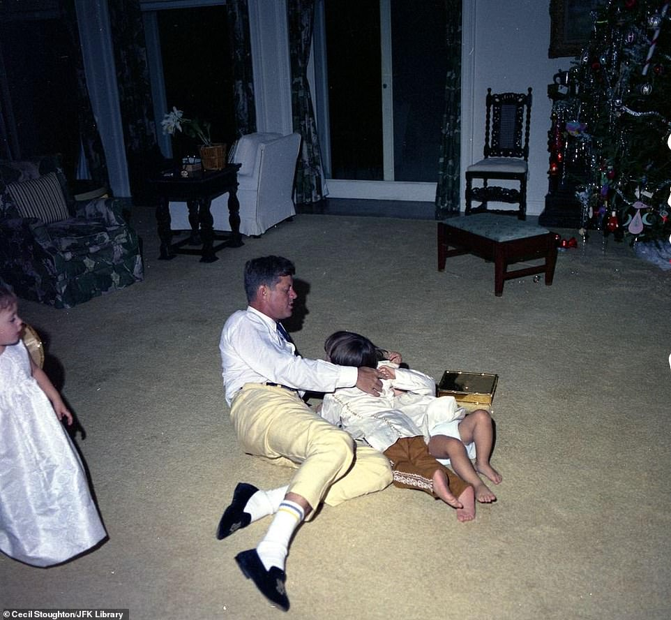 7433860-6497033-JFK_plays_with_his_son_John_F_Kennedy_Jr_right_partially_hidden_-a-12_1545752636744.jpg