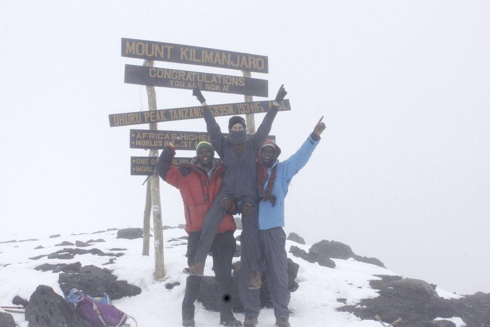 Climbing_Kilimanjaro_Summit_Uluru_Summit.jpg