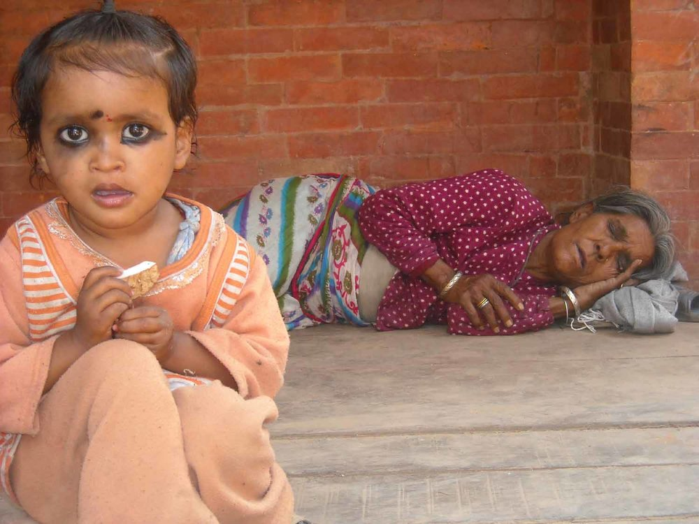 Bhaktapur - Child and sleeping grandmother.jpg
