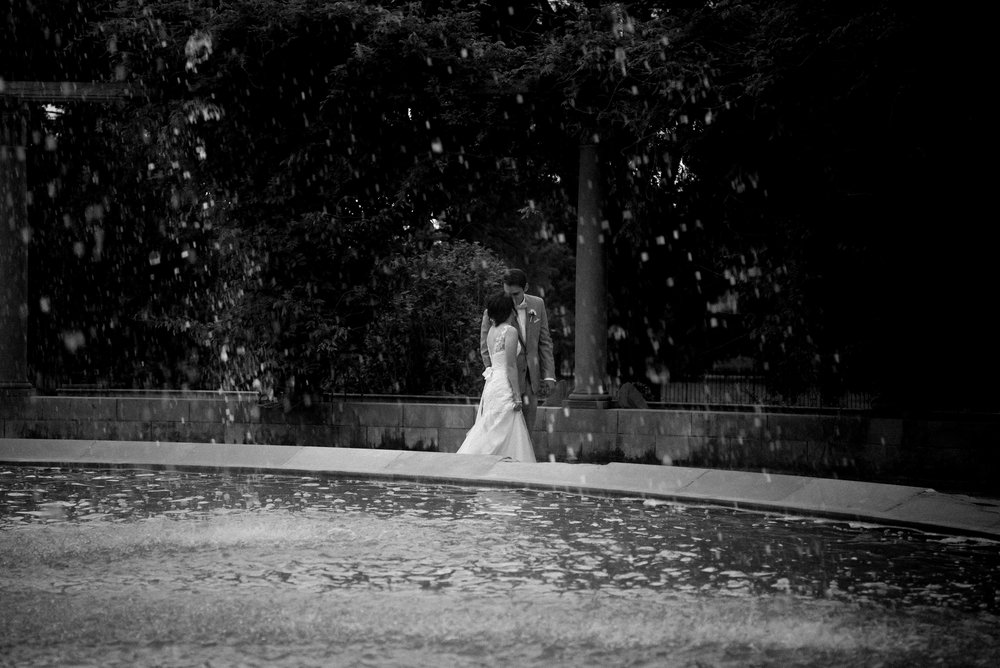 X Bride and Groom under fountain (1 of 1).jpg