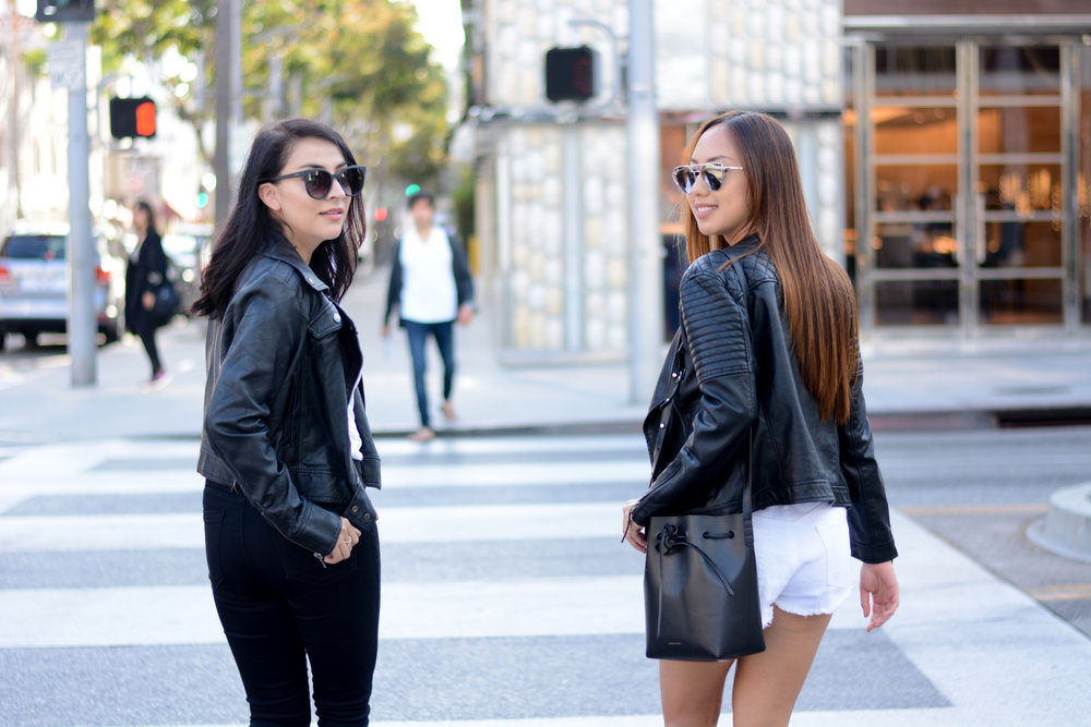 We have gotten a lot of love for our casual outfits, so we wanted to show one that was simple and easy to replicate, for all of you! Black is always a flattering color to wear and when you pair it with a contrast color (such as white), it creates an effortless look that will get you noticed. What really elevated our outfits was definitely our faux leather jackets and accessories.