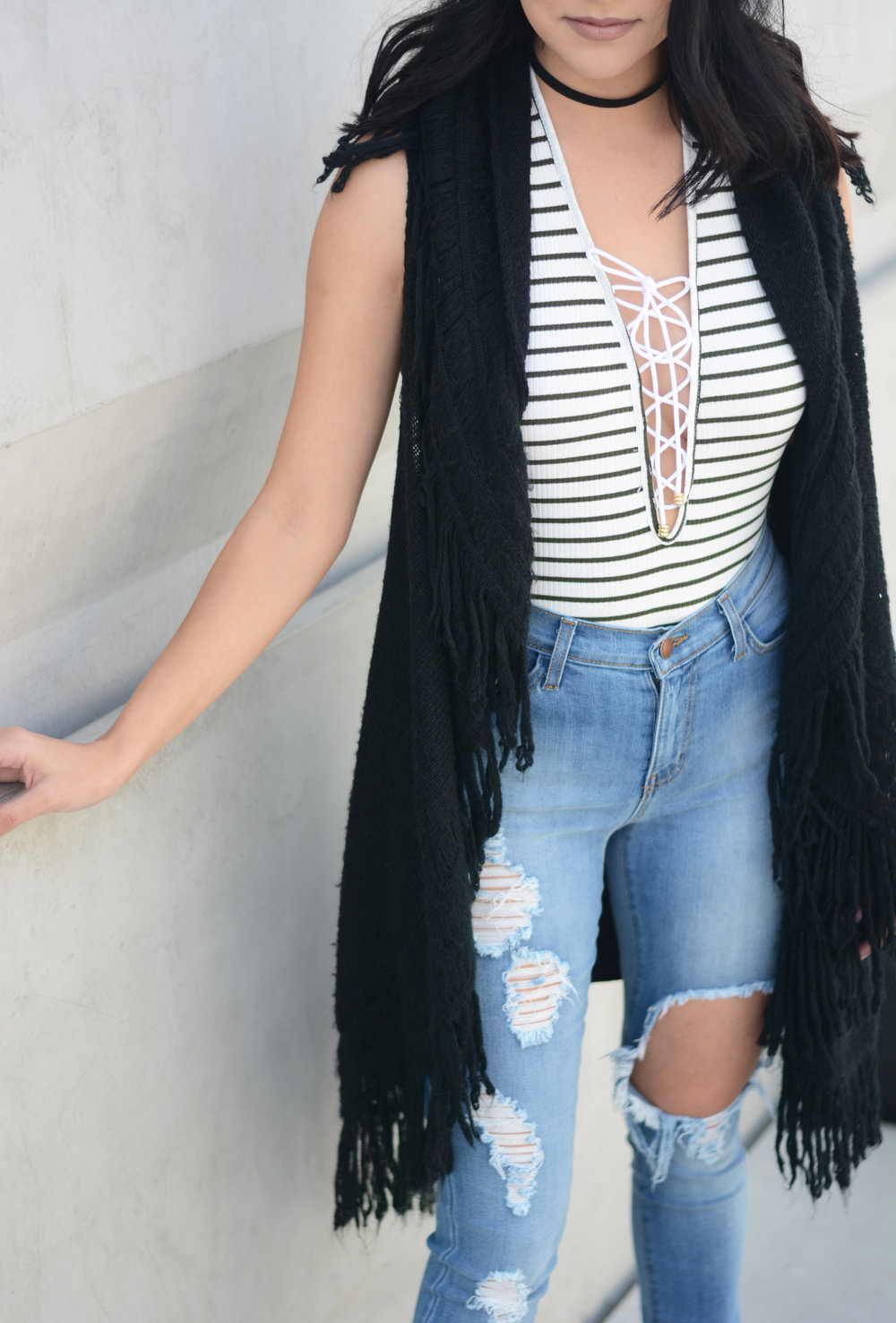 I layered my top with a fringe vest. It's perfect for this temperamental weather and it added a little play to my look.