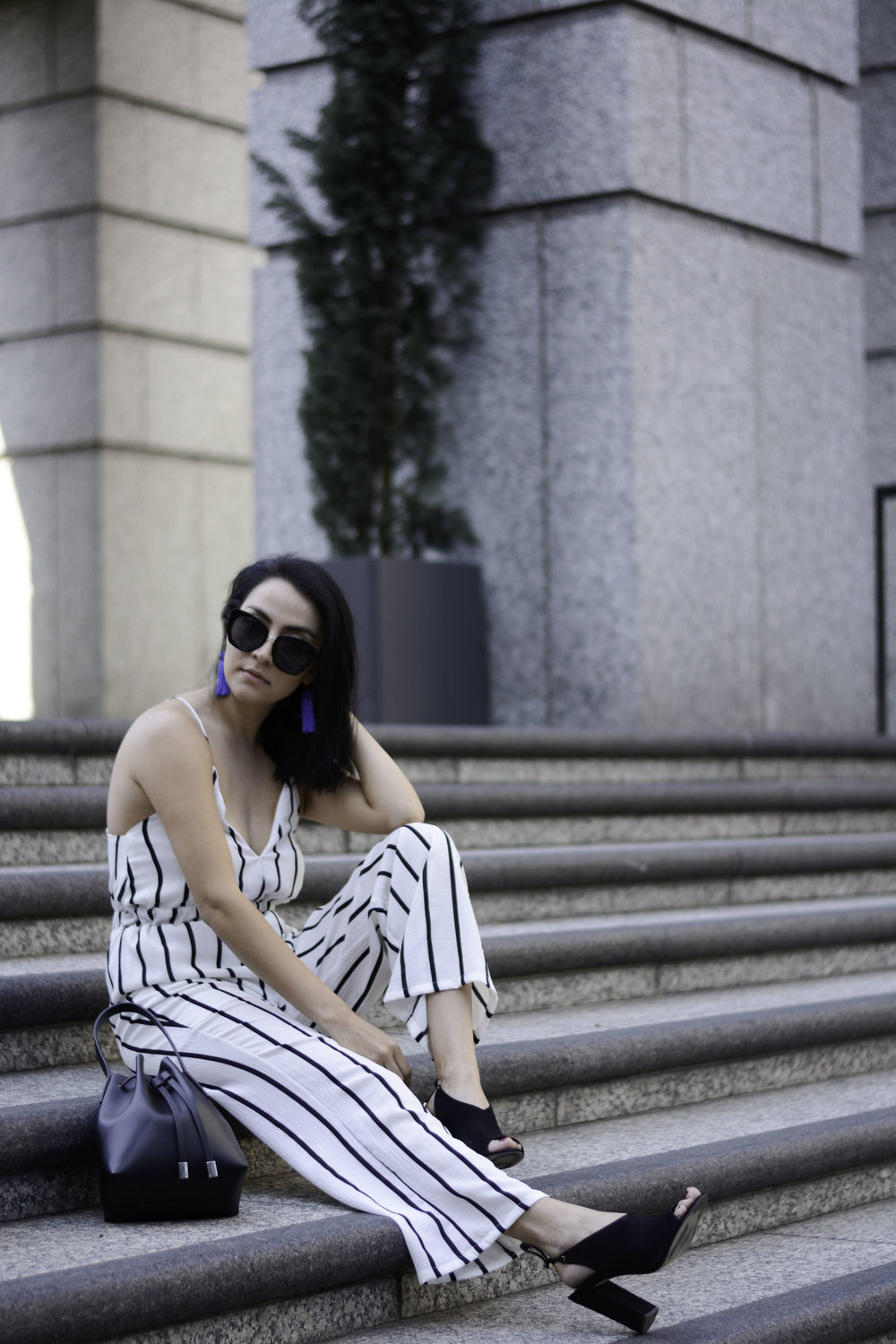 Some of the most popular items we saw in this striped trend were jumpsuits and pants. For this look, we kept it classic and chose a black and white monochromatic color scheme. However, another common theme in this trend was bright and bold colors which seemed to have been inspired by the 70s.