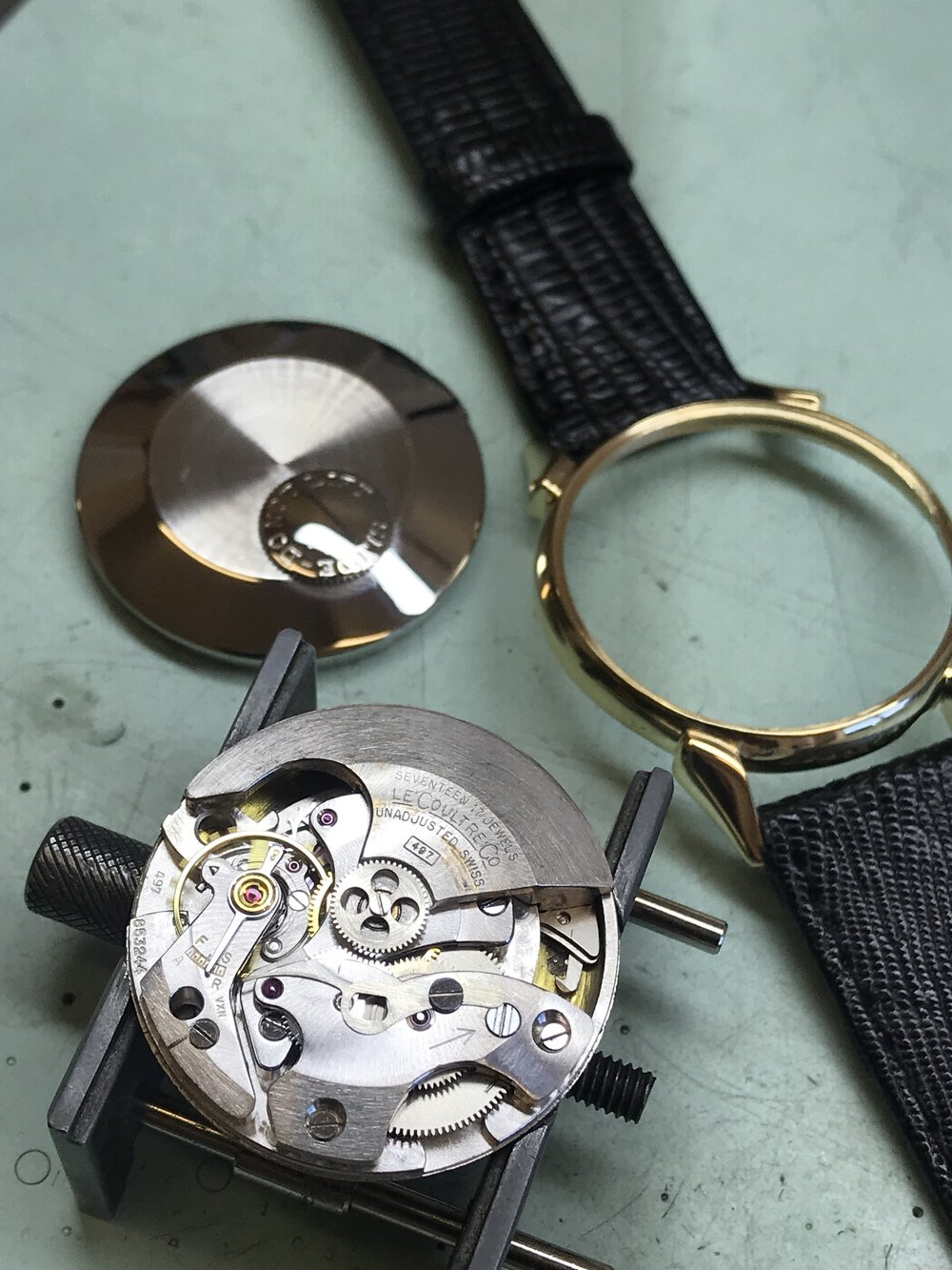 Photo of Le Coultre Co. movement. Bumper automatic winding weight shown.