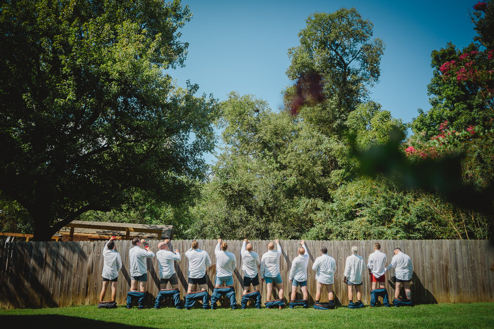 groomsmen taking a piss wedding photographer