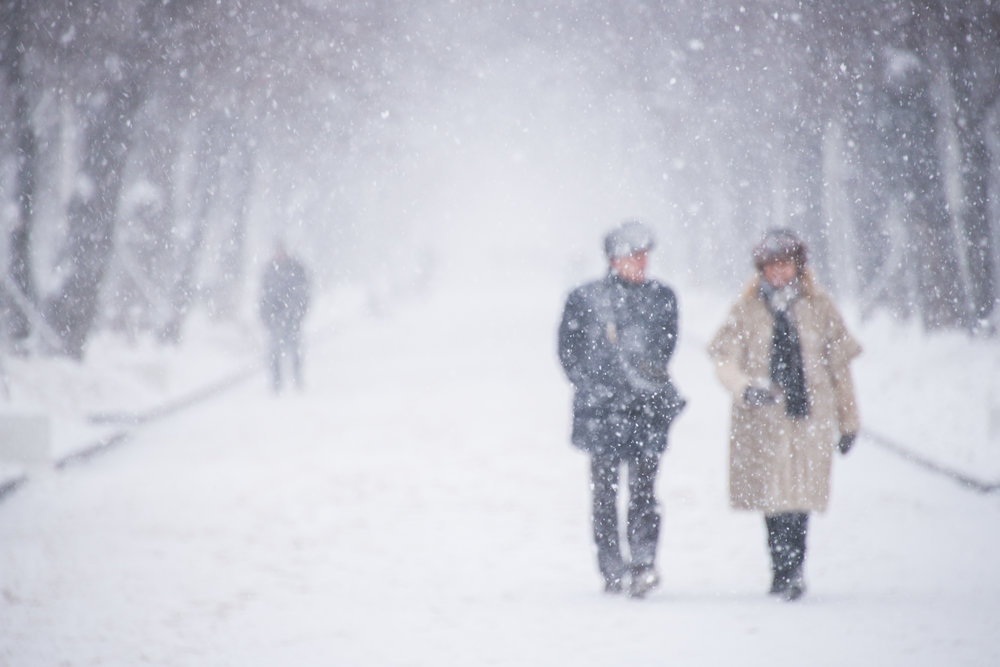 Couple in a snowstorm available framed (frame 50 x 70cm) or unframed (photo 40 x 50cm)