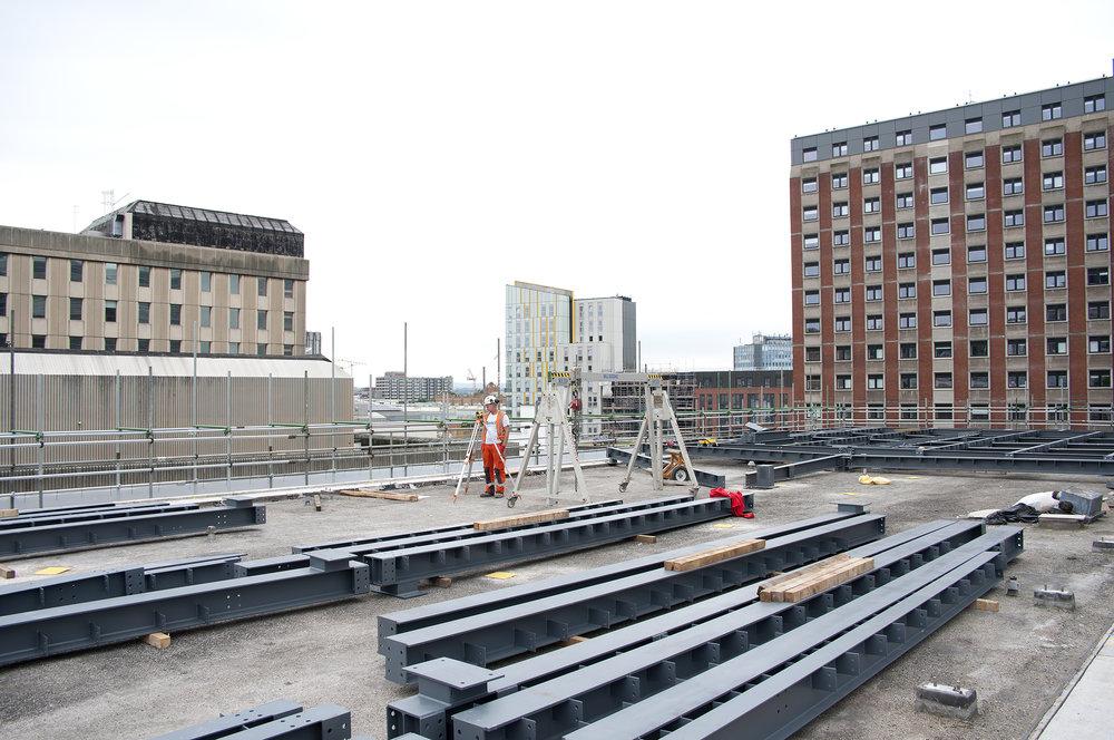 Property development progress documentation, installation of steel joists for roof garden
