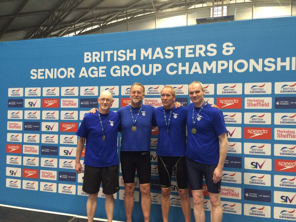 Stephen, Peter, Peter & Paul collecting their British Record medals for the 4x200m Freestyle record