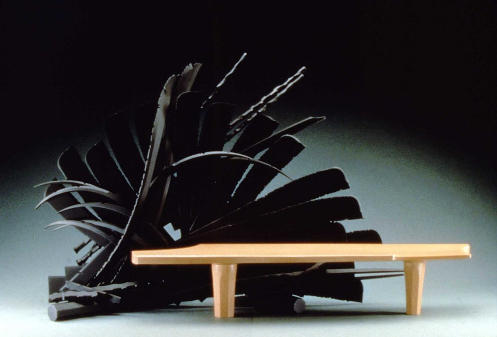 Albert Paley, Splayed Bench, 1992, Forged and fabricated steel with mahogany, Purchase made possible through the Kent Harrison Memorial Acquisition Fund and through donations from Norma Canelas and William Roth; Mrs. Kirk McKay, Jr.; Lucia and David Taxdal; Mr. and Mrs. T.R. Tucker; Mr. and Mrs. David Bunch; Homer Hooks and Lois Cowles Harrison; Mr. and Mrs. Richard M. Powers; Mr. and Mrs. A. Ernest Straughn, II; Clear Springs Land Company, LLC; The James Luffman Fund through the Community Foundation; Lisa and Robert Rath; Peggy Spirakis; Tampa Electric Company; Mr. and Mrs. Joseph S. Buck; Sue and Randy Bentley; Mrs. John F. Collins; Dr. and Mrs. Thomas McLaughlin; Susan M. Spelios; Mr. and Mrs. Robert Macey; C.B. and Dixie Myers; Terry and Julius Aulisio; Wayne and Pat Ezell; Brian R. Propp; Mr. and Mrs. Mark Sessums; Catherine and Daniel E. Stetson; Sheryll and Carl Strang; Marilee Truitt; Diane Van Dusen; Mischelle Anderson; James W. and Sandra J. Robinson; Bill and Ruby Stinson; and Carmelita Amann, Polk Museum of Art Permanent Collection 2002.18