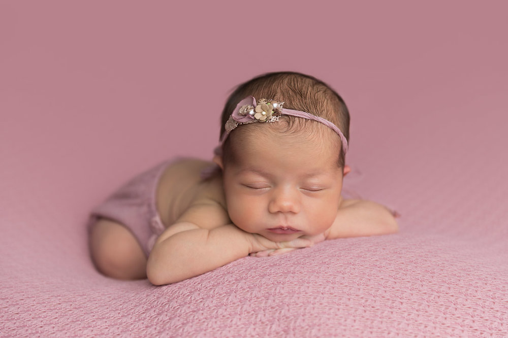 Contact me  if you have any questions or would like to book your newborn portrait session.
