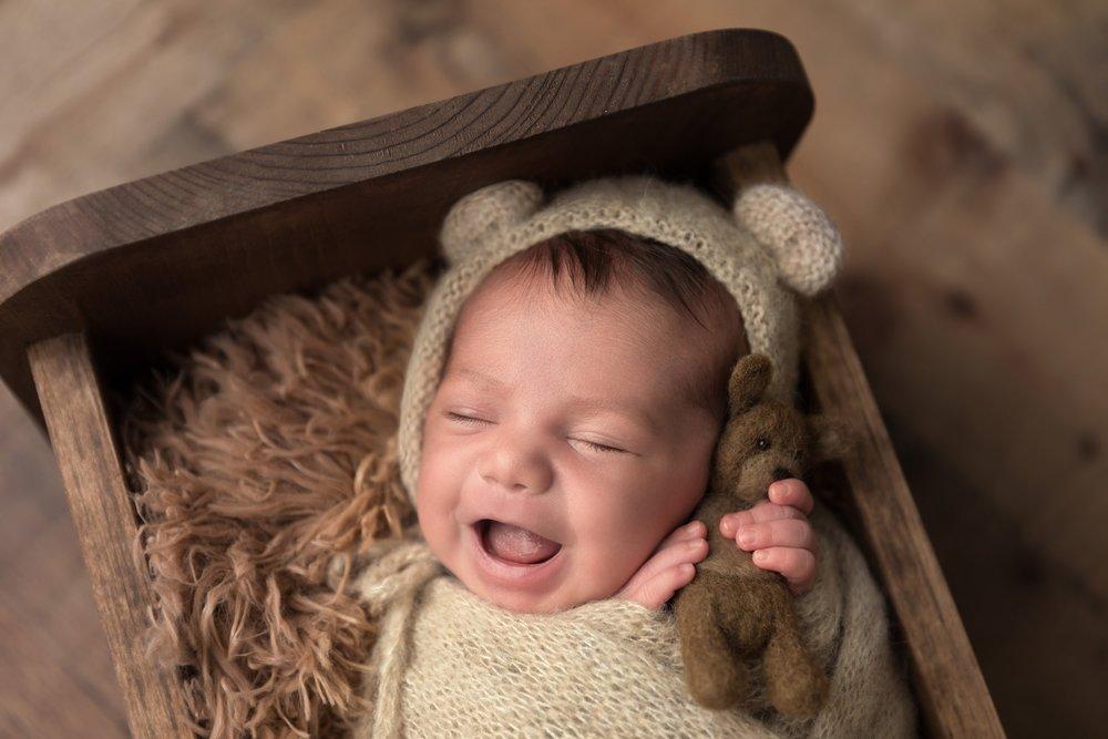 austin newborn with bear.jpg