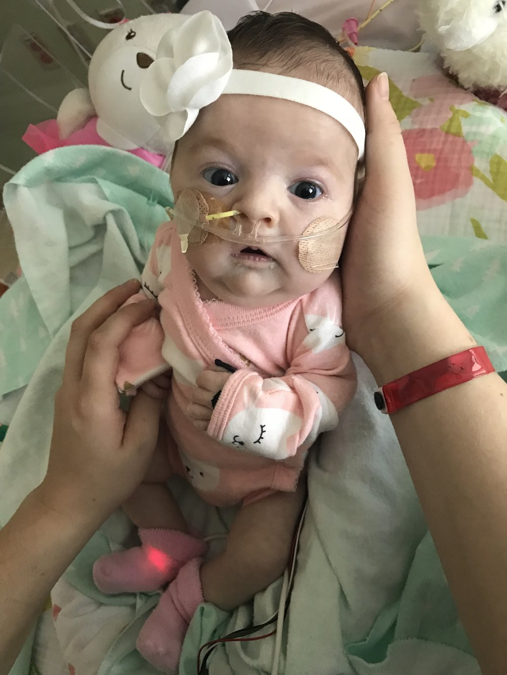 One month after her first surgery.