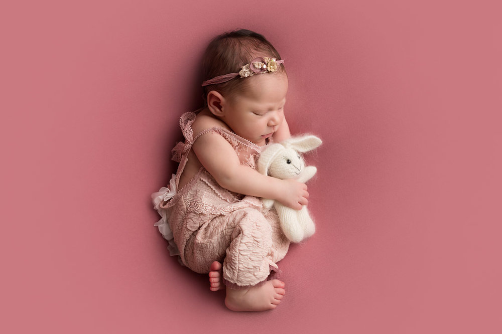 newborn with bunny prop