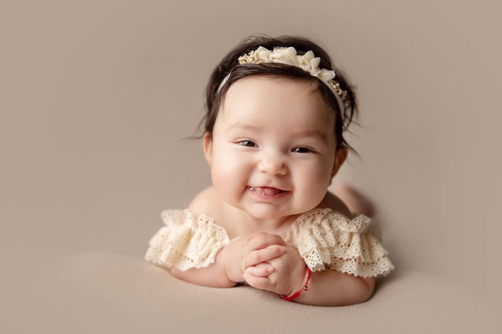 tummy time milestone baby smiling