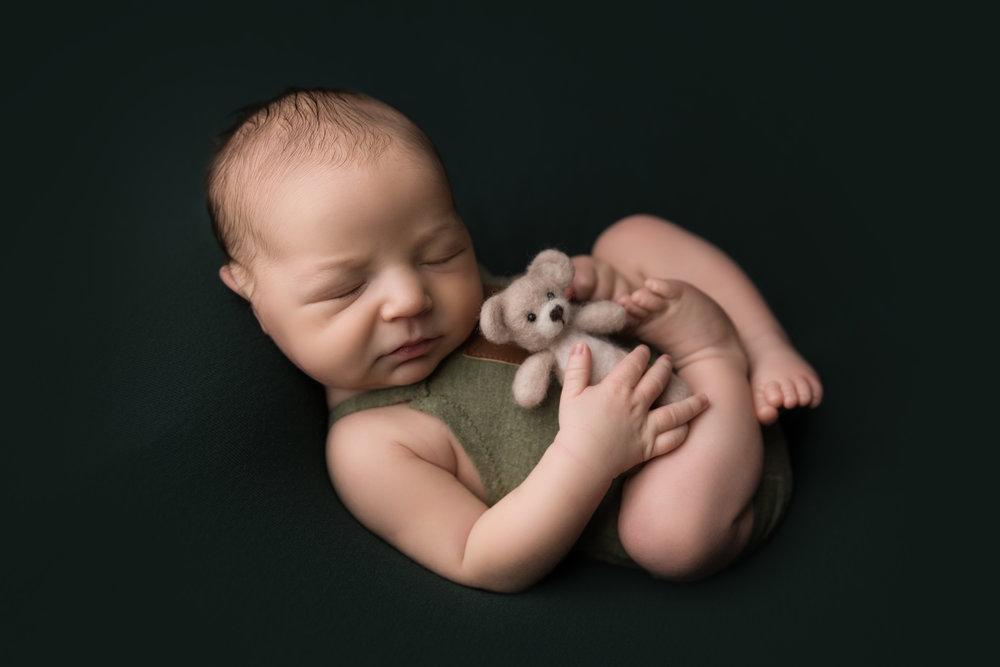 newborn with bear huck finn pose
