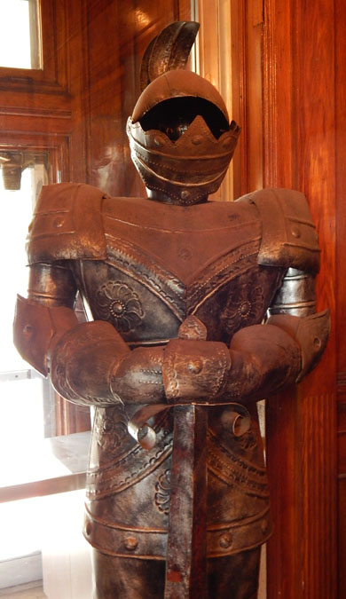 A suit of armor inside the front door greets visitors.  Is this a survivor from the White collection?