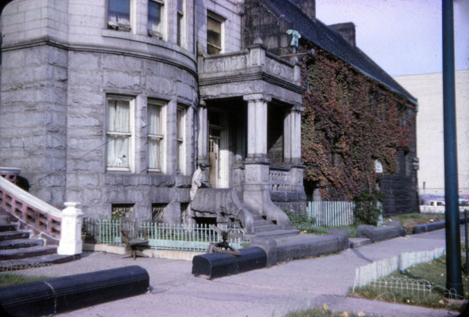 Charles A. Jackson sitting on the porch of 1808 S. Prairie Avenue in 1965 (Photo by Jack Simmerling)