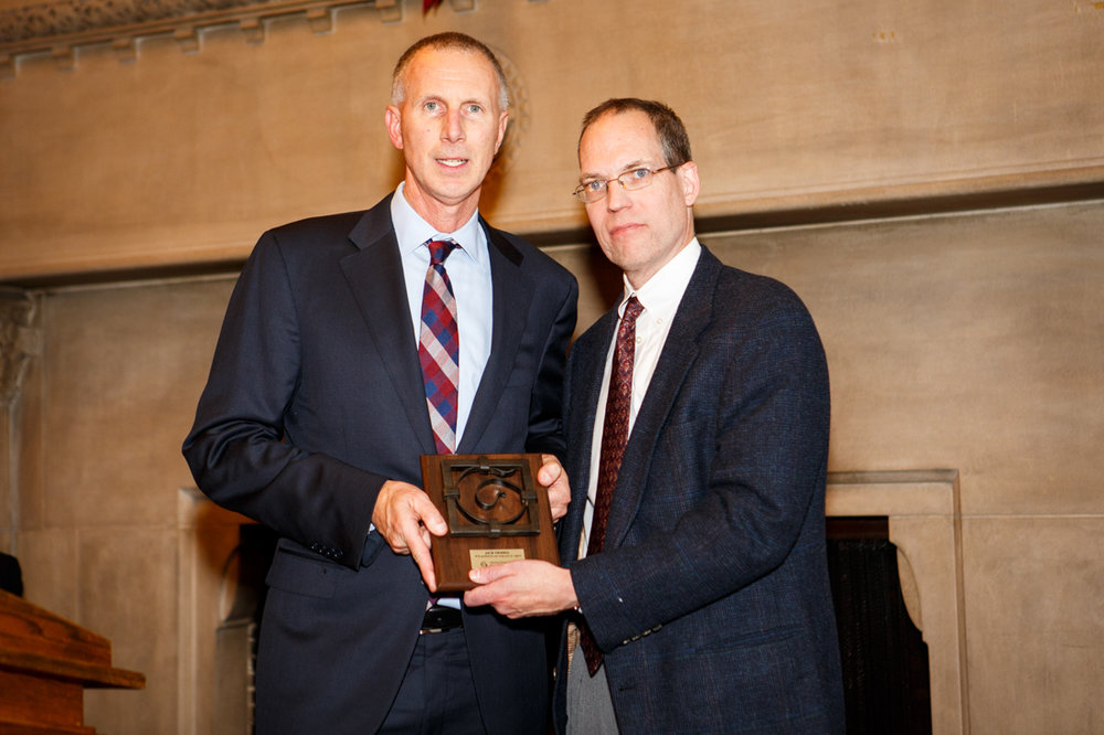 Jack Tribbia accepting award from John Waters