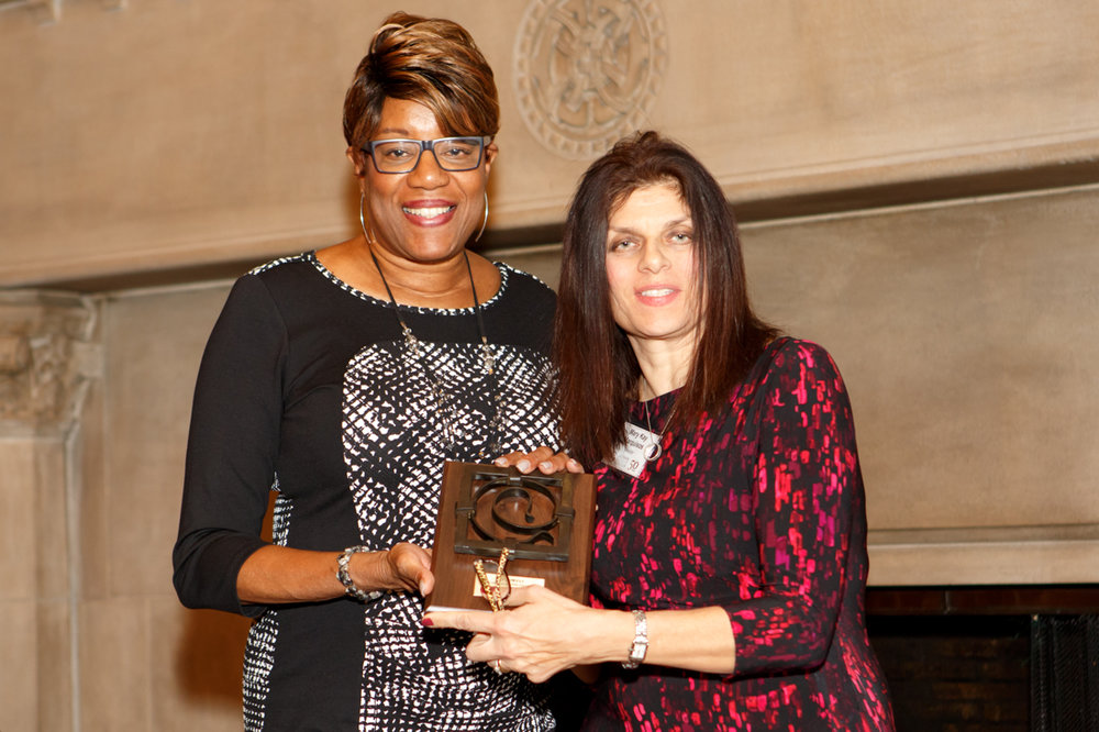 Ald. Pat Dowell accepting award from Mary Kay Marquisos