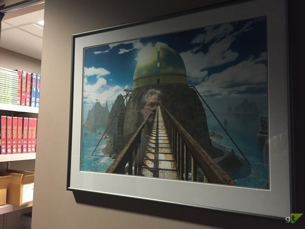 Rand Miller, co-creator of the  Myst  series, reflecting, literally, on a limited edition print of a render from the game  Riven .