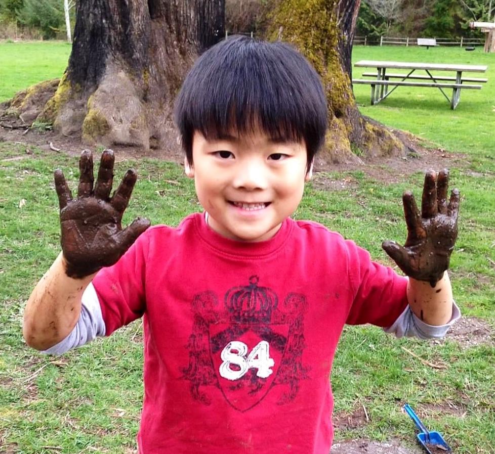 Taiyo muddy hands.jpg