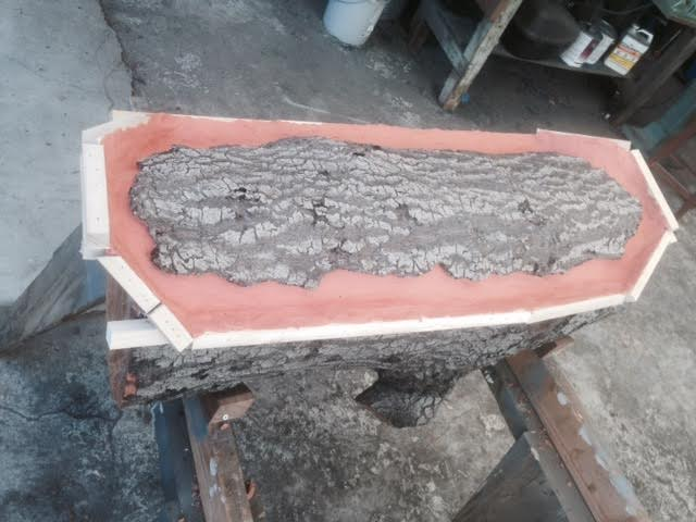 Adding clay to create level area on wood sculpture photo by Martin Pierce hardware Los Angeles, CA  90016
