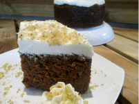 CARROT A tall moist cake, heavy with grated carrots, pineapple and walnuts. Topped with thick cream cheese icing!