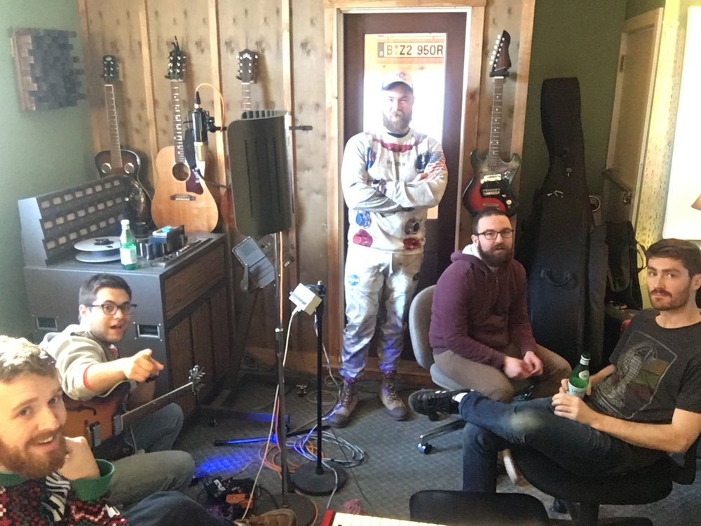 "In this extremely awkward picture, we're hard at work in the studio recording our forthcoming single, ""Nothin' but Love."" We can't wait to share it with you!"