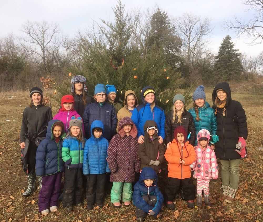Bluestem Mixed-Age Kindergarten and 6th Grade classes feed the animals in the winter with a winter stewardship tree.