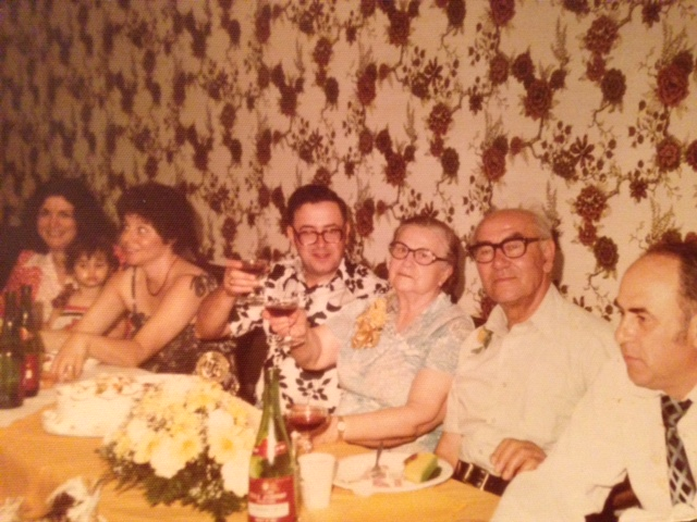 Me at age 2, on Mom's lap. Surrounded by our family and some very happening wallpaper. Donora, PA.