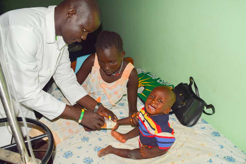 A physician at Memorial Christian Hospital provides medical aid to a child in South Sudan.