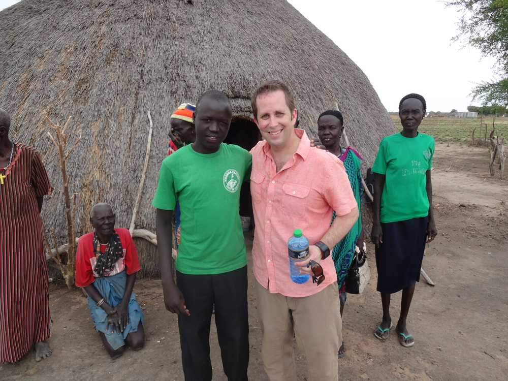 Scott Bowman (RIGHT), a managing partner at Clareo, with Gnong, an orphan from the village surrounding Memorial Christian Hospital in Bor, South Sudan.