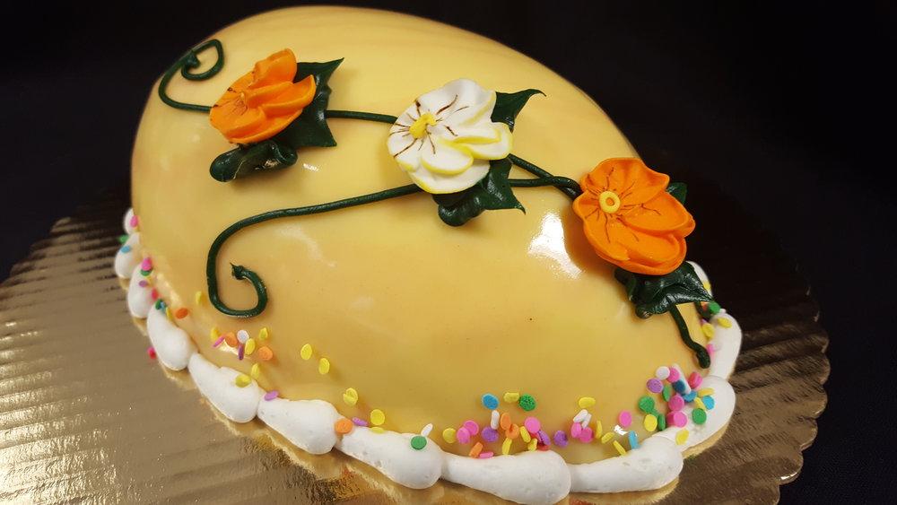 Easter Egg CakeVanilla Orange - Vanilla cake with orange cream cheese filling and ashiny marble glaze.