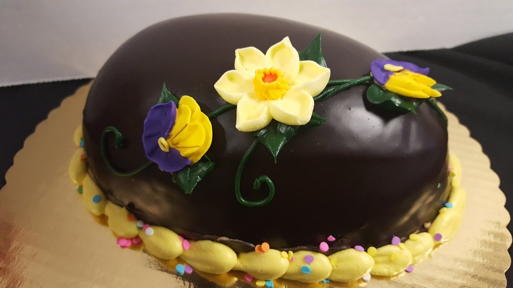 Easter Egg CakeChocolate Mousse - Chocolate cake filled with chocolate mousse, glazedwith ganache.