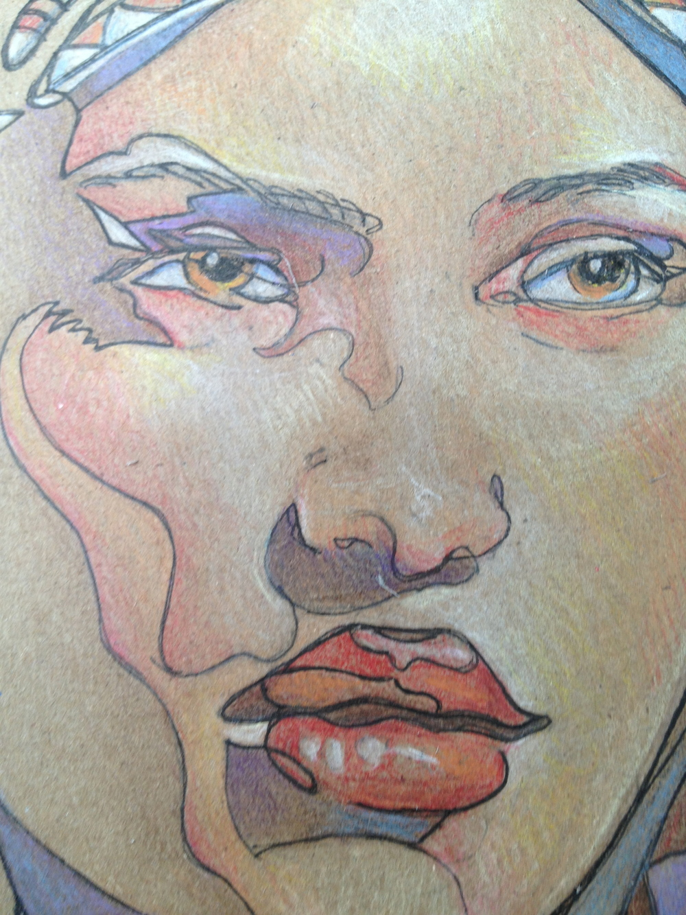 In this closeup you can see how the color pencil is built up. Use the direction of your pencil strokes to build up the shaping of your drawing. Burnish the colors to brighten them and make them pop.
