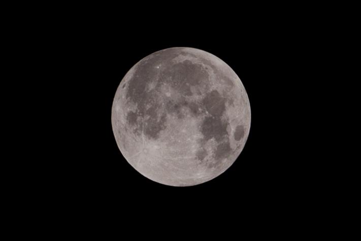 Silvery grey super moon in the Norfolk Sky.