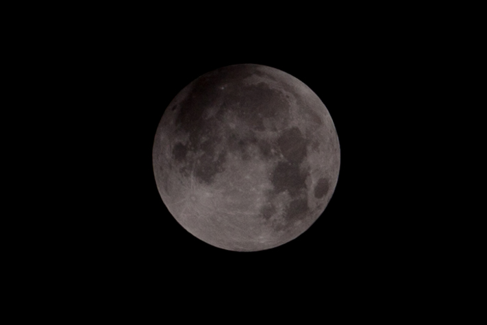 The Earths shadow starts to creep over the Moon