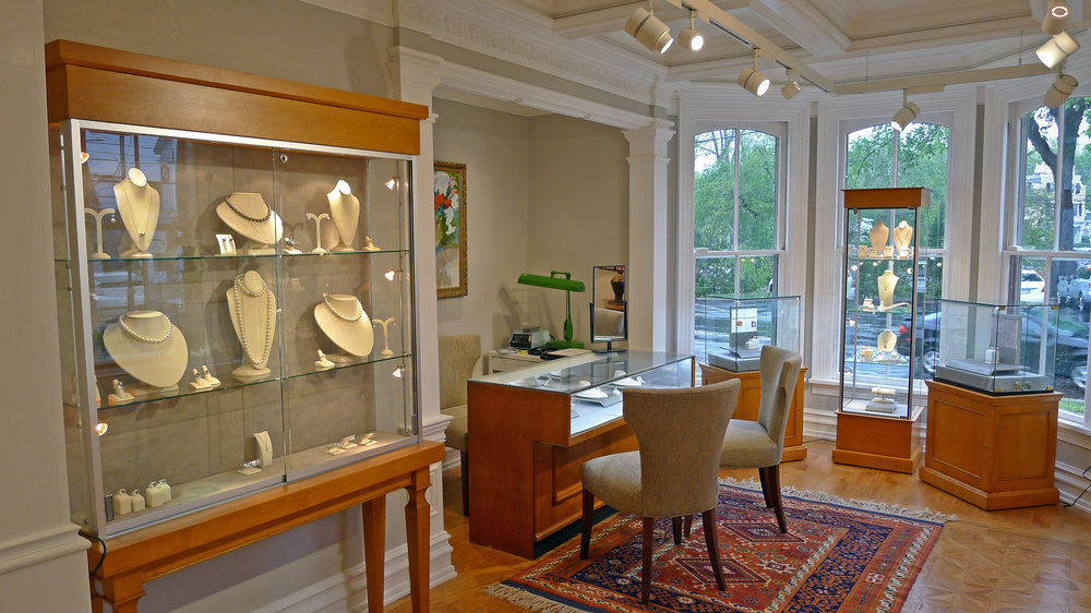 The perfect setting - Step into a world of fine woodworking detail, oil paintings, and antiques, all designed to showcase the pieces of fine jewelry created by T. Foster & Co.