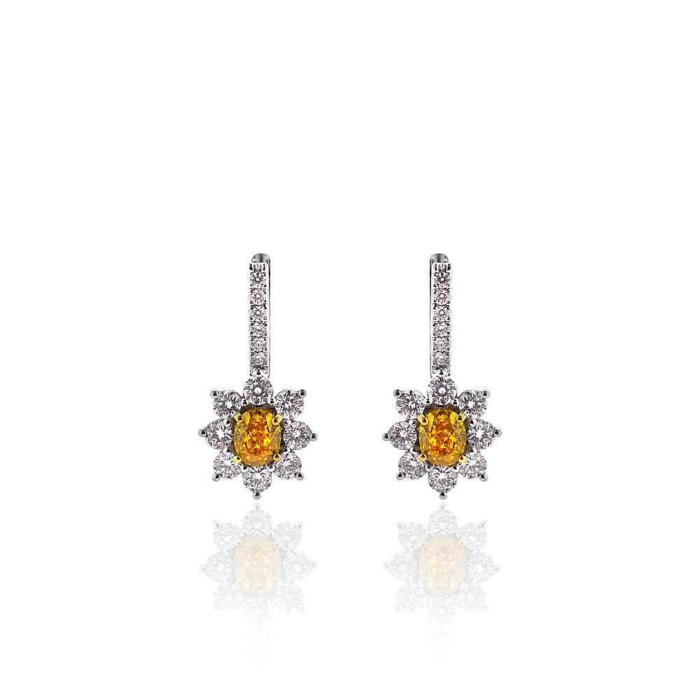 Fancy Yellow Diamond Earrings, $13,500