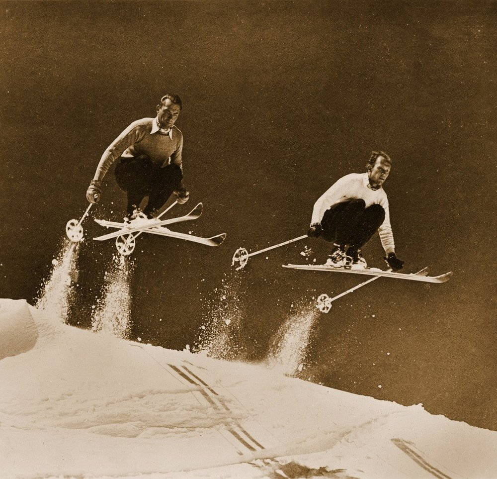 2_skiers_catching_air_1200x.jpg