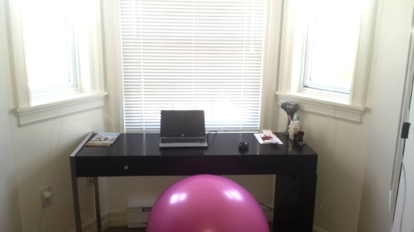 "My office as of June 2017. My bedroom has two small alcoves with a bay window, and I use one of those as my ""office."" All I have is a small desk and an exercise ball used as a chair. I do have some not so work related items on my desk, e.g., makeup, but they don't seem to have negative impact on my productivity :)"