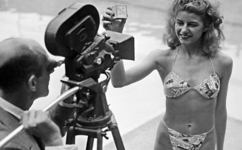 Nude dancer Micheline Bernardini wearing Louis Reard's 'Bikini' at a press conference, 1946