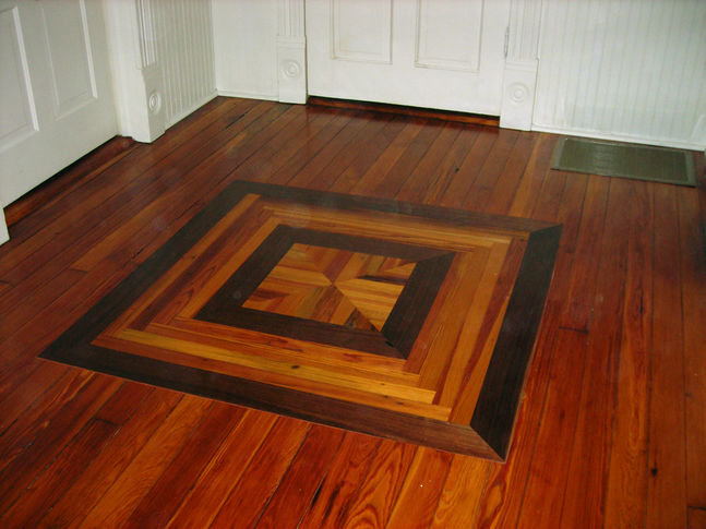 1024x485_fit_Custom-Floor-Inlay-Walnut-and-Heart-Pine.jpg