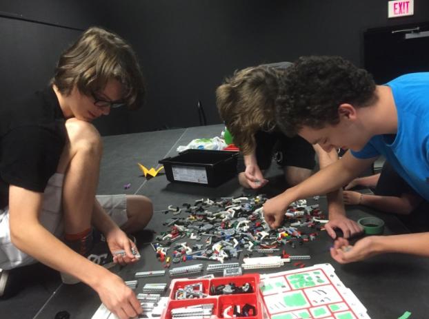 Daniel, Carter and Jamie assembling FLL Lego Kits