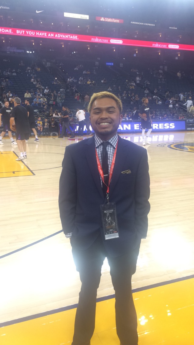 Brandon Cadiz courtside on the floor at   Oracle Arena  .