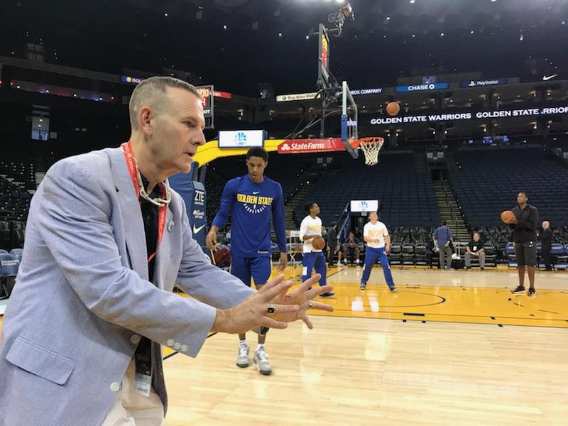 Dominican University Professor Bradley Van Alstyne having fun courtside while watching the Golden State Warriors practice before the game.
