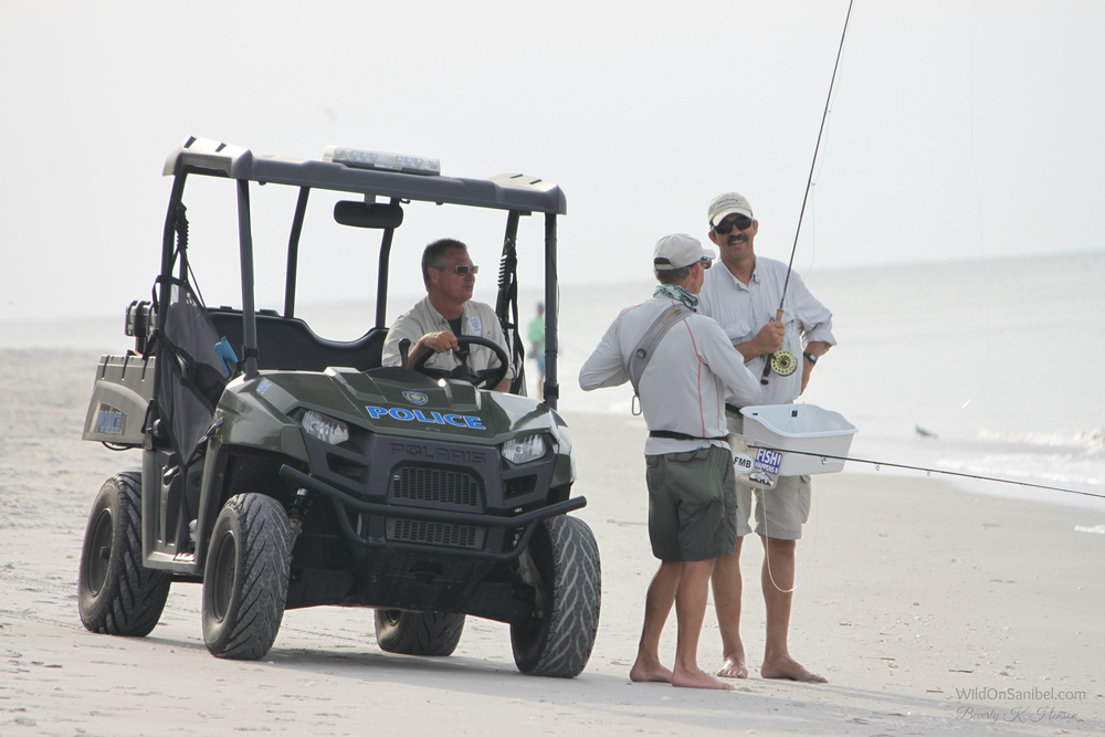 Sanibel's finest checking to make sure these guys had their fishing license!