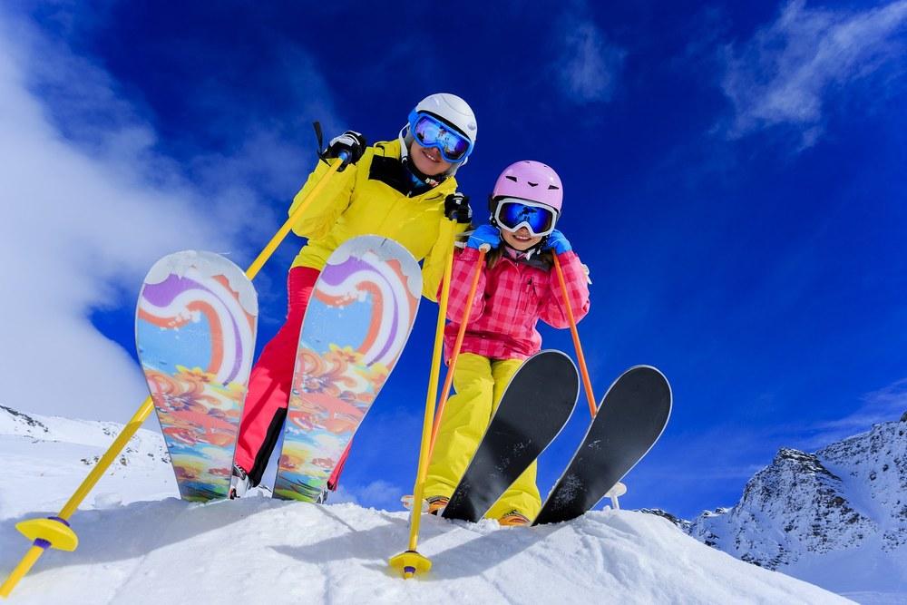 bigstock-Ski-skiers-sun-and-winter-fu-51676351.jpg