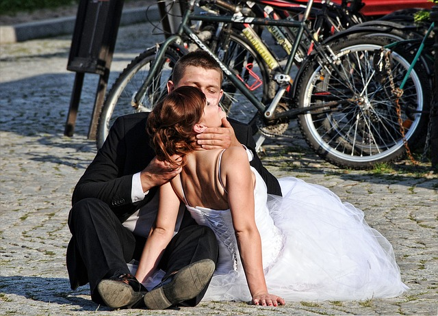 Another great example of bad wedding photography.  Love the use of the bicycles in the backdrop - I'm not quire sure what value that adds to the photo.  And is the bride dying?  It looks like the groom is holding her as she takes her last breaths.